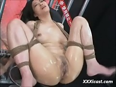 Asian tied oiled and toyed