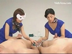 Asian girl learning how to give handjob