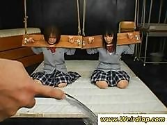 Two Naughty Asian Schoolgirls Are Put In Blocks And Tortured With Water